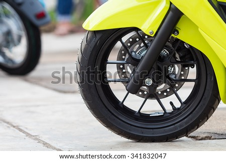 Close up front wheel of motorcycle. - stock photo