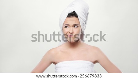 Close up Frustrated Fresh Young Woman Wrapped her Body and Hair with Bath Towel. Isolated on White Background. - stock photo