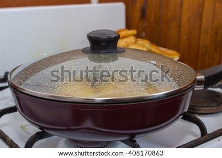 close-up frying pan on a gas stove - stock photo