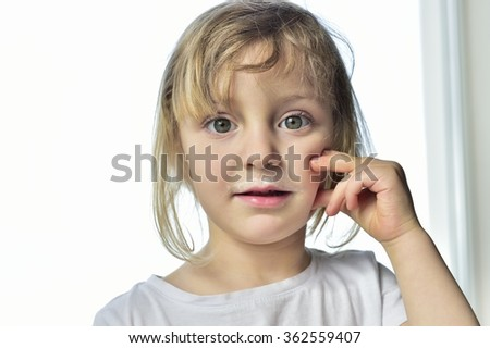 Close up fun portrait of cute  little girl with milk moustaches. Portrait of a little happy girl with yogurt on the face. - stock photo