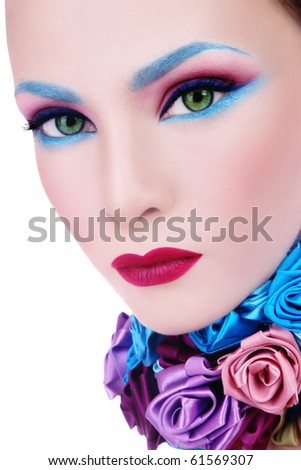 Close-up glamorous portrait of young beautiful woman with fancy blue make-up and collar of silk roses - stock photo