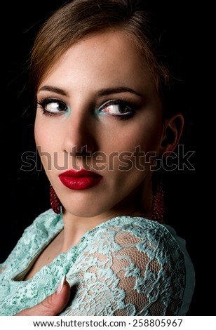 Close up Glamorous Young Woman in Lace Mint Green Dress Staring to the Right of the Frame on a Black Background - stock photo