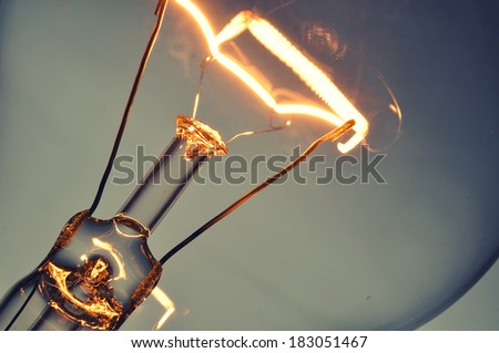 Close up glowing light bulb - stock photo