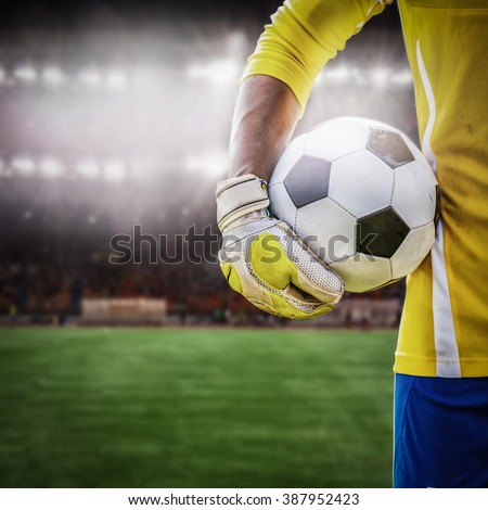 close up goalkeeper holding soccer ball in the stadium  - stock photo