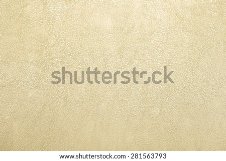 Close up Golden color leather texture background - stock photo