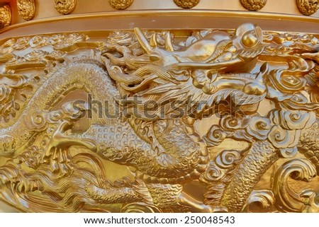 Close up golden dragon sculpture on incense burner in the public Chinese temple. - stock photo