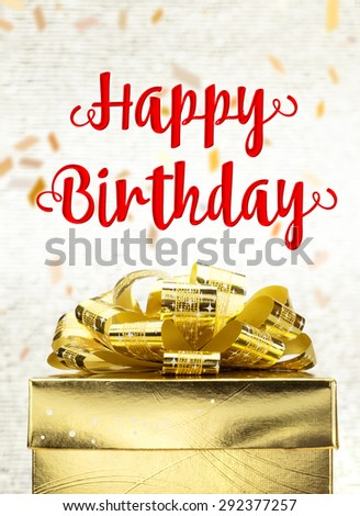 Close up Golden present box with Happy Birthday word and confetti blur background - stock photo
