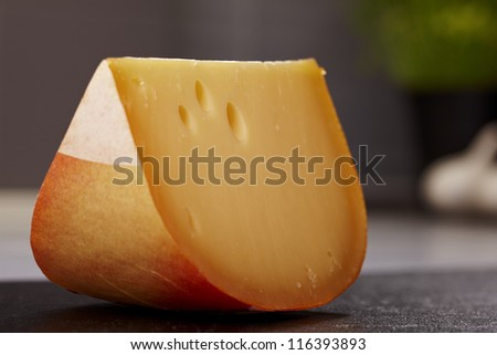 Close up gouda cheese in a kitchen - stock photo