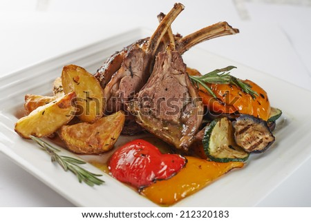 Close-up Gourmet Main Entree Course Grilled Rib Chops Isolated White - stock photo