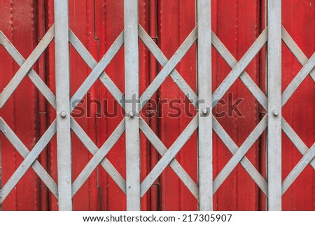 close-up gray and red rusty sliding metal door  - stock photo
