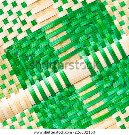 Close up green and natural color weaved bamboo texture - stock photo