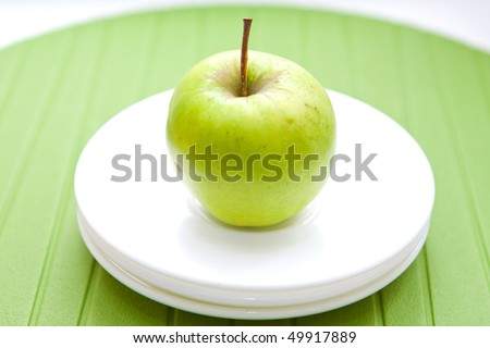 close up green apple on the white plates - stock photo