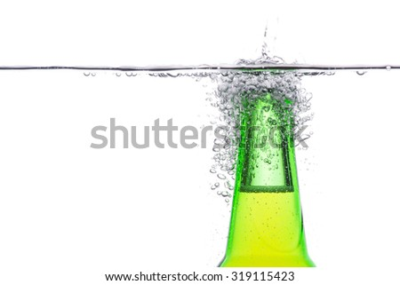 Close up Green beer bottle with water splash isolated on white - stock photo