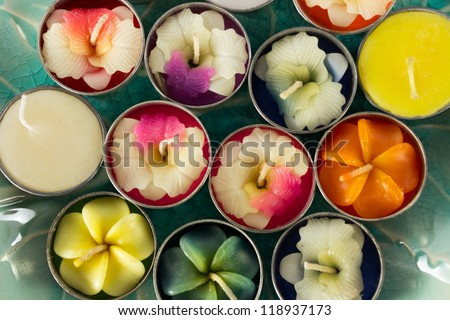 Close-up group of colorful flower shaped candles. - stock photo
