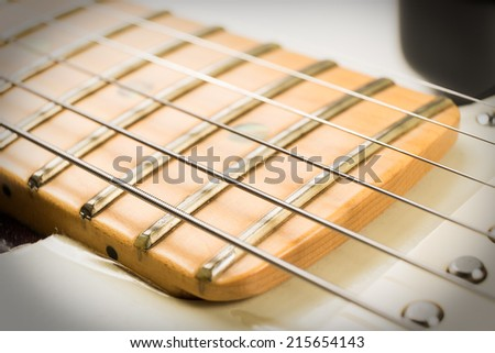 close up guitar and strings with shallow depth of field - stock photo
