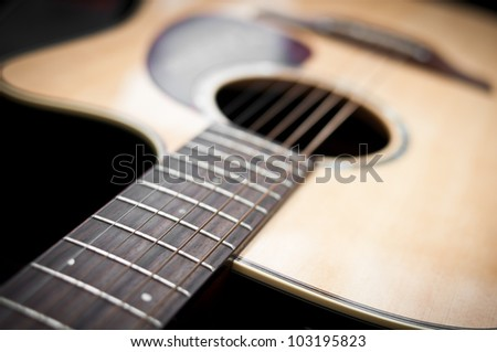 Close-up guitar body with sound hole and strings - stock photo