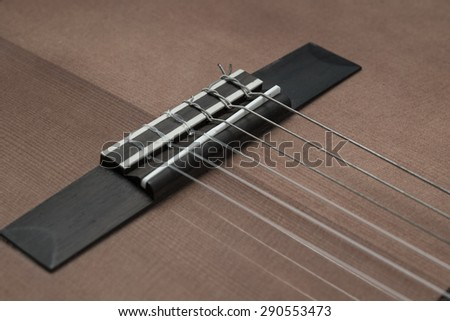 Close up Guitar Strings and guitar bridge ,vintage style - stock photo