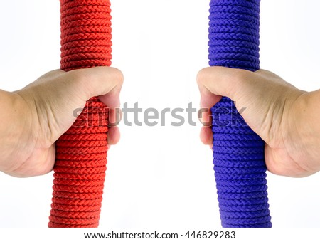 close up hand hold red and blue rope on white background and copy space for text - stock photo