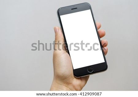 Close up hand holding black phone on white clipping path inside. - stock photo
