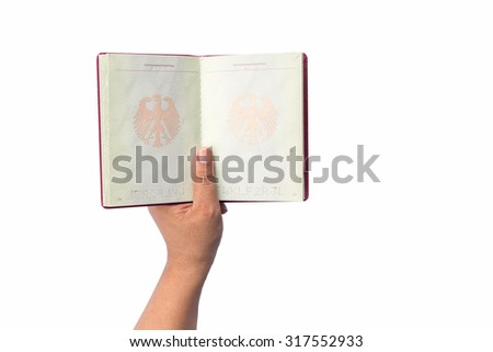 Close up hand holding German passport isolated on white background - stock photo
