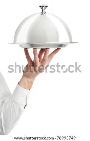 Close up hand of waiter with metal cloche lid cover and tray - stock photo
