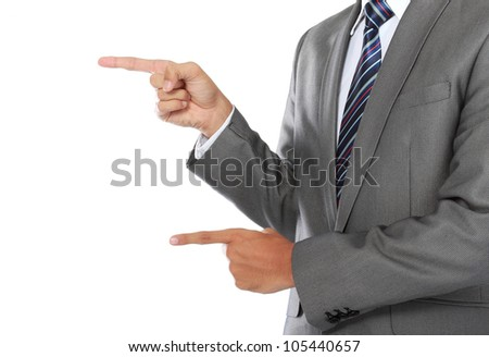 close up hands of business man pointing his finger to the copyspace - stock photo