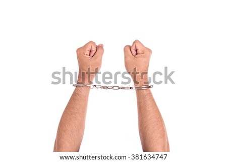Close up hands with silver handcuffs isolated on white background - stock photo