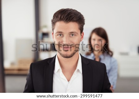 Close up Handsome Young Businessman Inside the Office Smiling at the Camera In Front of his Partner. - stock photo