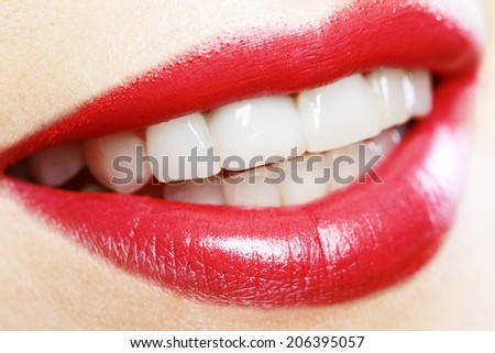 Close-up happy female smile with healthy white teeth, bright gloss lips make-up. Cosmetology, dental and beauty care  - stock photo