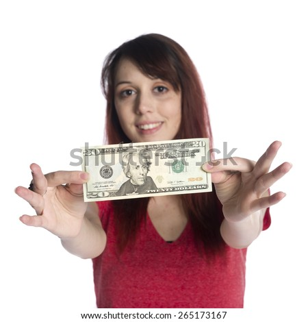 Close up Happy Young Woman Showing 20 US Dollar Bill While Looking at the Camera, Isolated on White Background. - stock photo