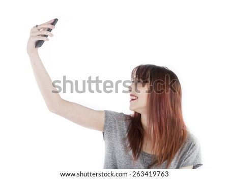 Close up Happy Young Woman Taking Selfie Photo Using her Molbile Phone, Isolated on White Background. - stock photo
