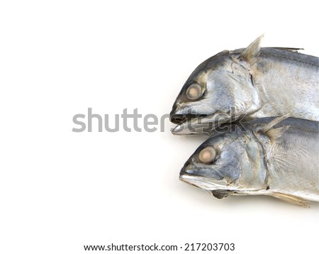 Close up 2 Head Mackerel fish in bamboo basket Isolated on white - stock photo