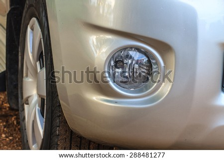 Close up headlights of car background and texture - stock photo