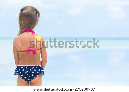 Close up heart painted by sun cream on kid shoulder - stock photo