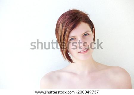 Close up horizontal portrait of a beautiful redhead woman - stock photo