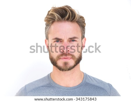 Close up horizontal portrait of a serious man with beard isolated on white background - stock photo