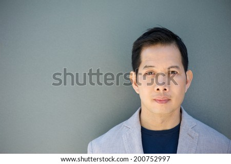 Close up horizontal portrait of an asian man with serious expression - stock photo