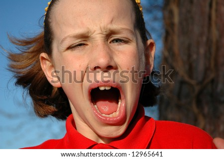 close-up humorous portrait of girl - stock photo