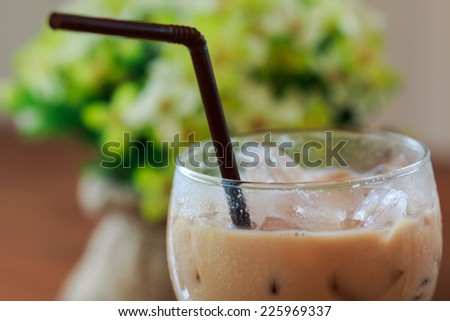 close up Ice coffee in with straw glass - stock photo