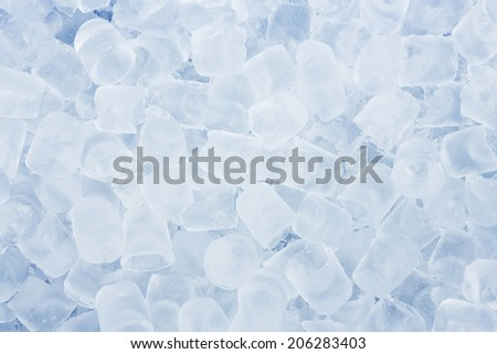 Close up ice cube in blue cooler box - stock photo