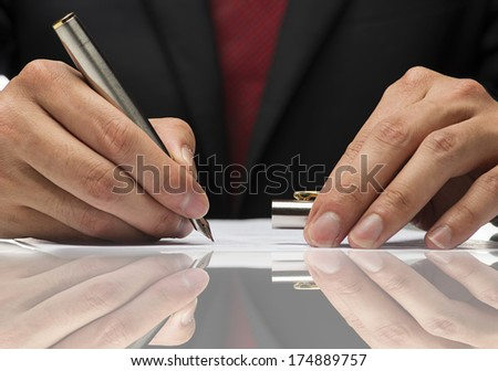 close up image hand writing a paper with reflection. - stock photo