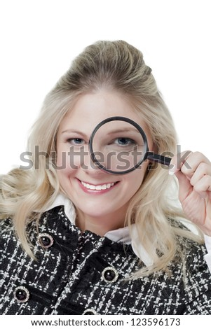 Close-up image of a beautiful woman holding magnifying glass smiling in a white surface - stock photo