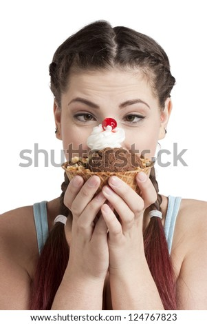 Close-up image of a beautiful woman with delicious ice cream isolated on a white surface - stock photo