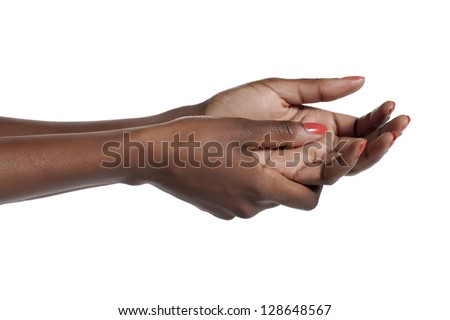 Close-up image of a begging hand of a woman against the white surface - stock photo