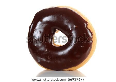 Close-up image of a chocolate glazed doughnut isolated on white background - stock photo
