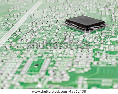 Close-up image of a circuit board and silicon chip - stock photo