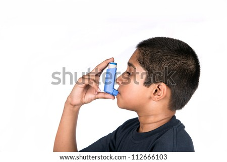Close up image of a cute little boy using inhaler for asthma. White background - stock photo