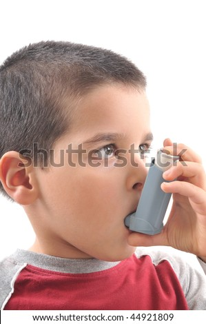 Close up image of a cute little boy using inhaler for asthma. White background vertical studio picture. - stock photo
