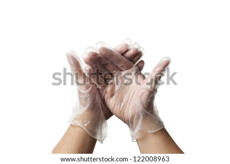 Close-up image of a human hands in surgical gloves. - stock photo