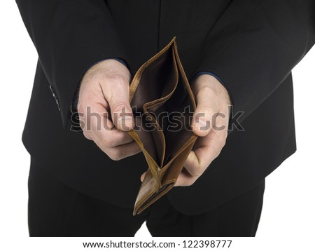 Close-up image of a man's hand showing an empty wallet over the white background - stock photo